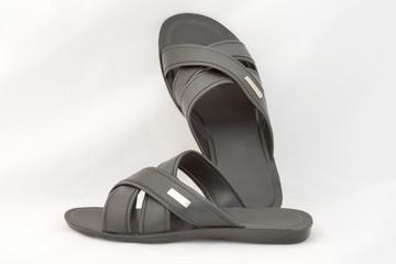 Black Slippers on White