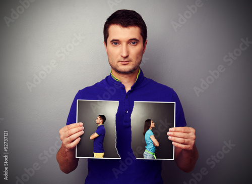 young man holding the lacerated photo