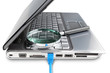 Modern laptop and internet cable magnifier to search for informa