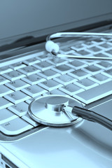 Modern laptop and stethoscope to diagnose problems close up. On
