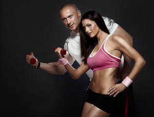 Very attractive fit couple at the gym .
