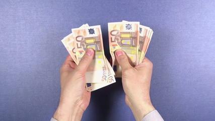 counting 50 euros banknotes