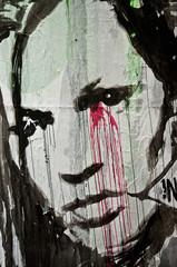 Graffiti visage bléssé