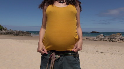 pregnant showing her belly