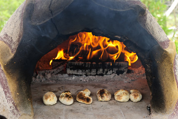 Stone wood oven baking bread