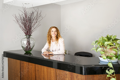 Smiling woman at office reception