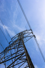 Electric high voltage tower with sky background