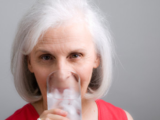Senior Attractive Woman Drinking Water