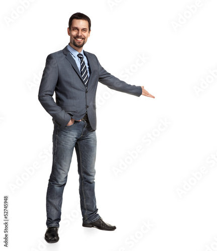 Happy businessman with arm out in a welcoming gesture