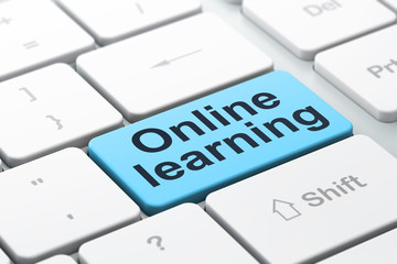 Education concept: Online Learning on computer keyboard backgrou