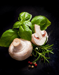 White mushroom with spice in black background