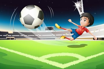 A football player kicking a ball
