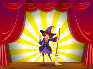 A witch at the stage with a red curtain