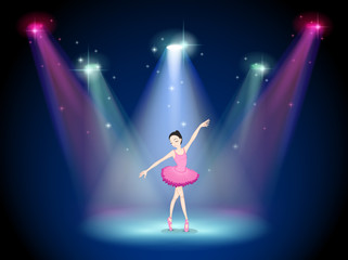 A graceful ballerina at the center of the stage