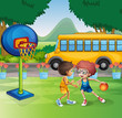 Two boys playing basketball near the school bus