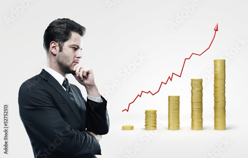 man looking on coins chart