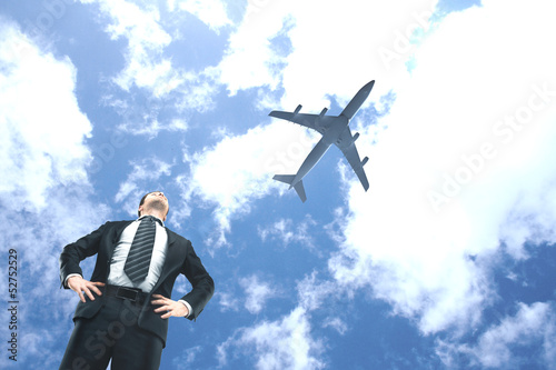 man looking on airplane