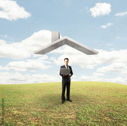 man standing under house roof