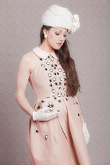 Romantic vintage fashion woman. Pink dress and white hat. Flower