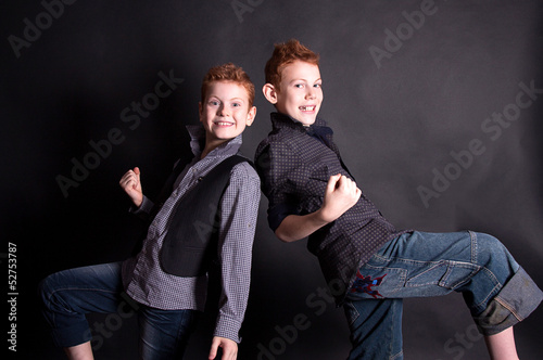 Cheerful red-haired boys on a black background