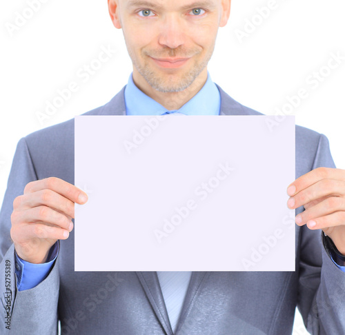 Nice businessman holds white poster.