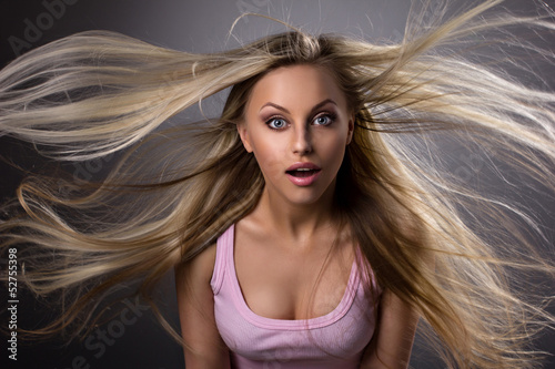 Amazed blond young woman