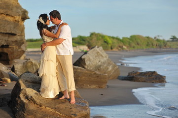 Beautiful beach marriage. the bride and groom against the ocean