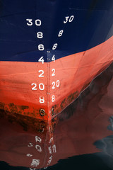 Bow of the cargo ship with draft scale numbering