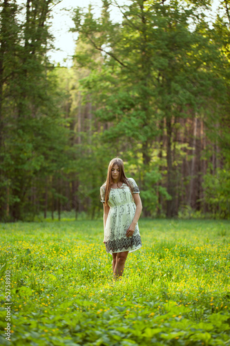 Beautiful girl among the wild flowers
