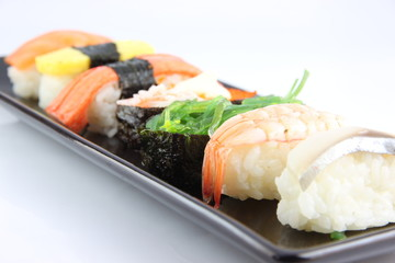 Sushi made ​​from seafood on Black dish.