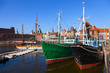 Old fishing boats on the background panorama of Gdansk, Poland.