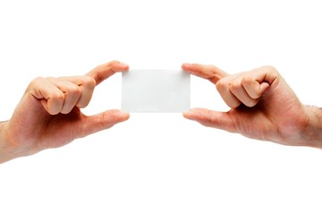 Blank business card in the hands of a businessman. isolated on w