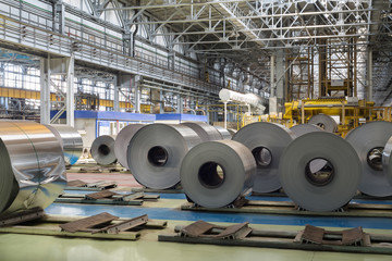 Rolls of aluminum lie in production shop of plant