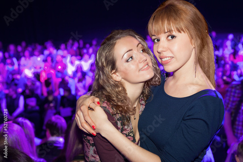 Two beautiful girls in a party posing for the camera