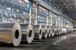Row of rolls of aluminum lie in production shop of plant. - 52761173