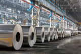 Fototapety Row of rolls of aluminum lie in production shop of plant.