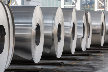 Rolls of aluminum close up in production shop of plant.