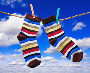 colorful socks hanging on clothespins