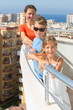Family of three on balcony of room at hotel on top floor