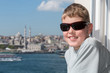Smiling boy in sunglasses against landscape with river