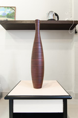 brown vase for dry wood on table
