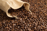 Fototapety jute bag on background of coffee beans