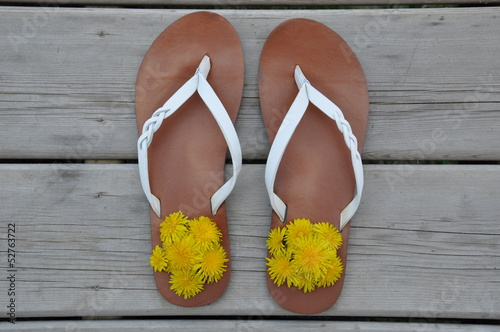 Pair of sandals with yellow flowers