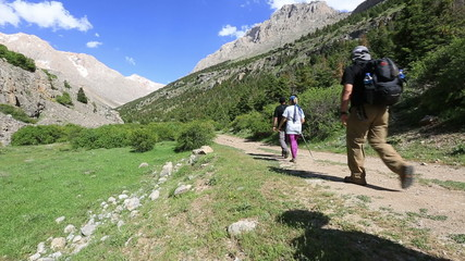 hiking group walking through valley