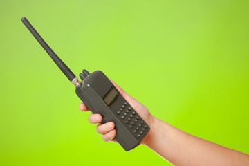 Hand with the walkie-talkie