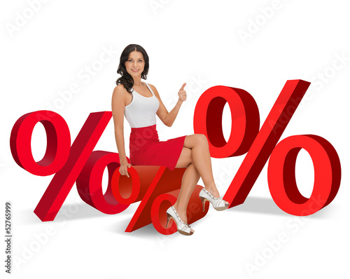 woman sitting on big red percent sign
