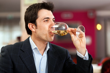 Man drinking wine at the restaurant
