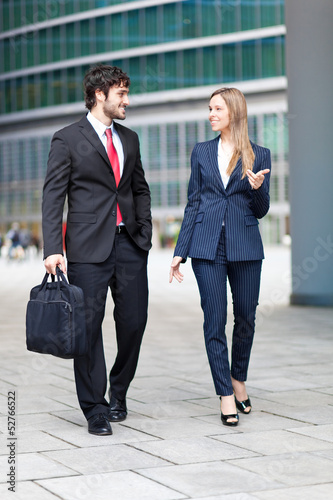 Portrait of businesspeople walking and talking