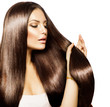 Beauty Woman touching her Long and Healthy Brown Hair