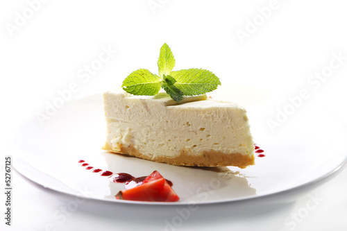 Fresh cheesecake served with mint